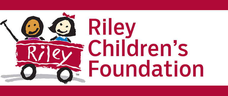 Riley Children's Foundation logo drawn by children with a red wagon with two smiling kids riding in the wagon